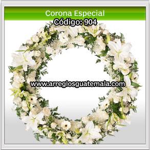 corona de flores realizada toda de flores naturales para enviar condolencias a familia que ha perdido a un ser querido